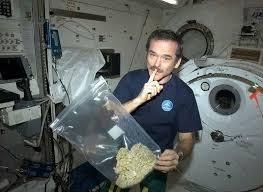 astronaut holding THC marijuana